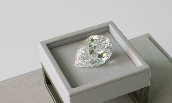 A rare pear-shaped D color flawless 100+ carat diamond is seen at Sotheby's in New York City,  on June 21, 2021. (Eduardo Munoz/Reuters)