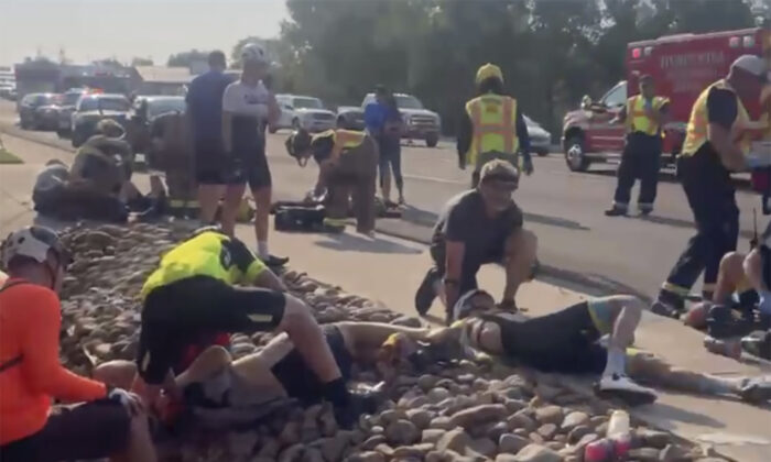 The aftermath of a truck ramming into a crowd of bikers on Saturday, June 19, 2021, in Show Low, Ariz. (Tony Quinones via AP)