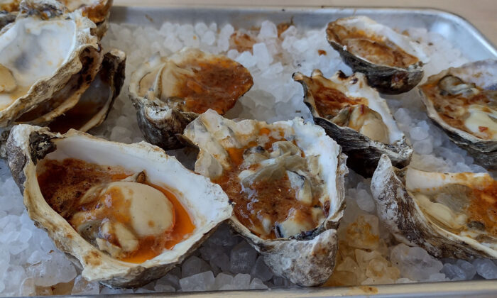 Fresh grilled oysters in bubbling chipotle butter are popular offerings on the menu at FINCA Paso Robles. (Courtesy of Jim Farber)