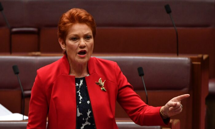 One Nation Senator Pauline Hanson in Senate chamber at Parliament House in Canberra, Australia on Dec. 2, 2019. (AAP Image/Mick Tsikas)