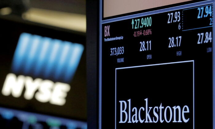 The ticker and trading information for Blackstone Group is displayed on the floor of the New York Stock Exchange (NYSE), on April 4, 2016. (Brendan McDermid/Reuters)