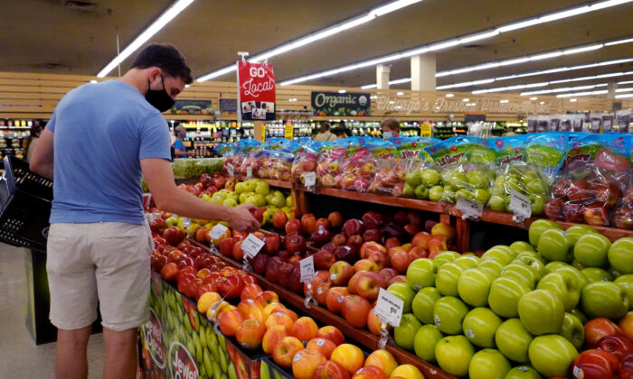 Customers shop for produce at a supermarket in Chicago, Illinois, on June 10, 2021. (Scott Olson/Getty Images)