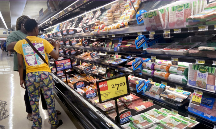 Customers shop for meat at a supermarket in Chicago on June 10, 2021. (Scott Olson/Getty Images)