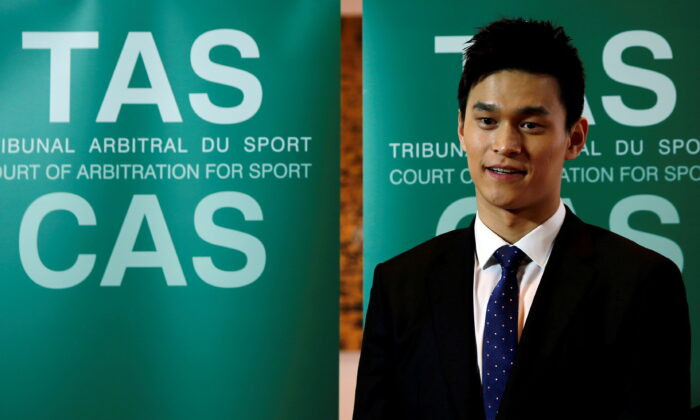 Chinese swimmer Sun Yang poses after a public hearing of the Court of Arbitration for Sport (CAS) at the Conference Centre of the Fairmont Le Montreux Palace, in Montreux, Switzerland, on Nov. 15, 2019. (Denis Balibouse/Reuters)