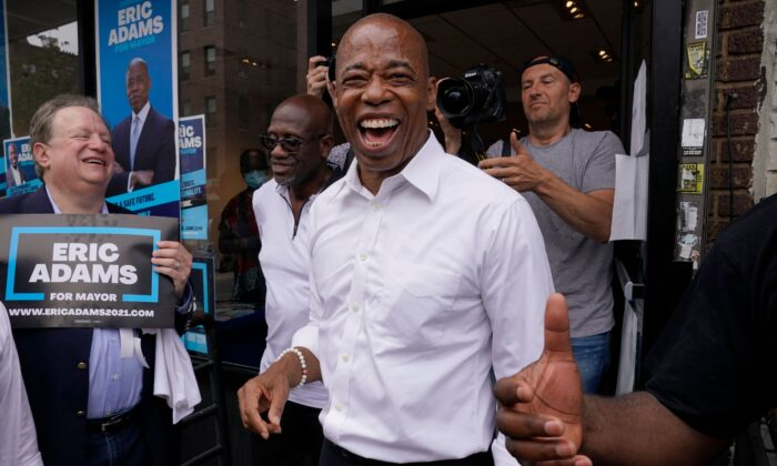 New York City Democratic Mayoral Candidate Eric Adams smiles during an event in Brooklyn on the eve of New York City Primary Election Day, on June 21, 2021. (Timothy A. Clary/AFP via Getty Images)