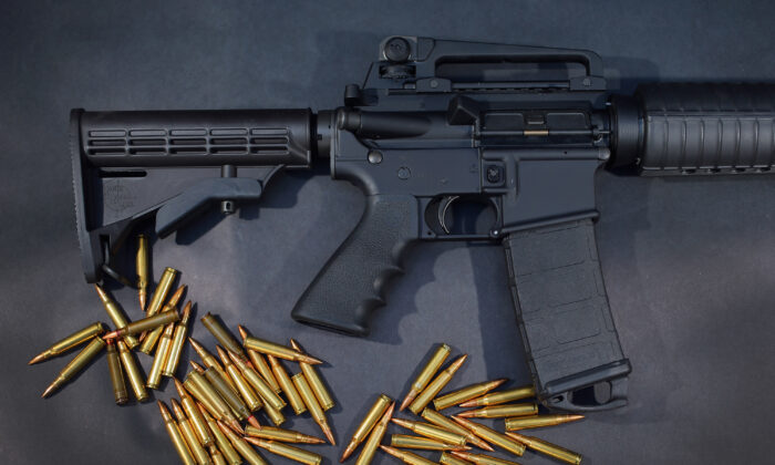 A Rock River Arms AR-15 rifle is seen with ammunition in Miami, Fla., on Dec. 18, 2012. (Joe Raedle/Getty Images)