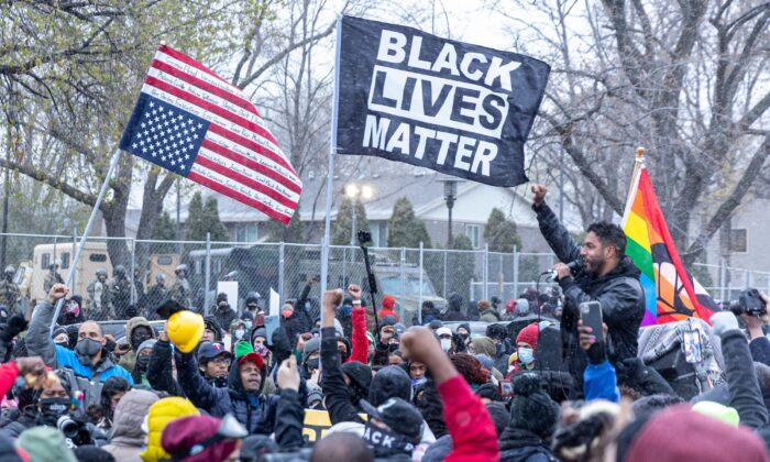 Protesters rally outside the Brooklyn Center police station in Minnesota on April 13, 2021. (Kerem Yucel/AFP via Getty Images)