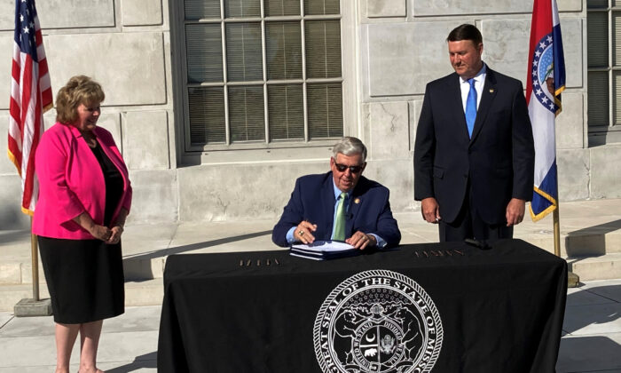 Missouri Gov. Mike Parson signs legislation in Jefferson City, Mo., on June 15, 2021. (David A. Lieb/AP Photo)