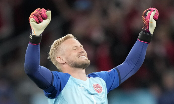 Denmark's goalkeeper Kasper Schmeichel celebrates at the end of the UEFA EURO 2020 Group B football match between Russia and Denmark at Parken Stadium in Copenhagen, Denmark, on June 21, 2021. (Martin Meissner/Pool/AFP via Getty Images)
