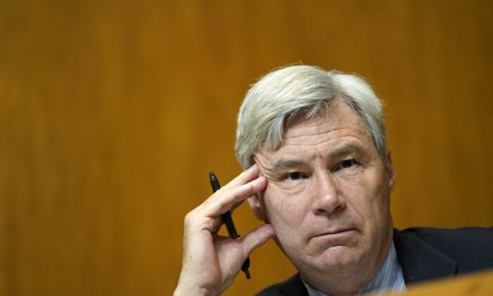 Sen. Sheldon Whitehouse (D-R.I.) listens during a hearing on Capitol Hill in Washington on Feb. 25, 2021. (Susan Walsh/Pool/Getty Images)