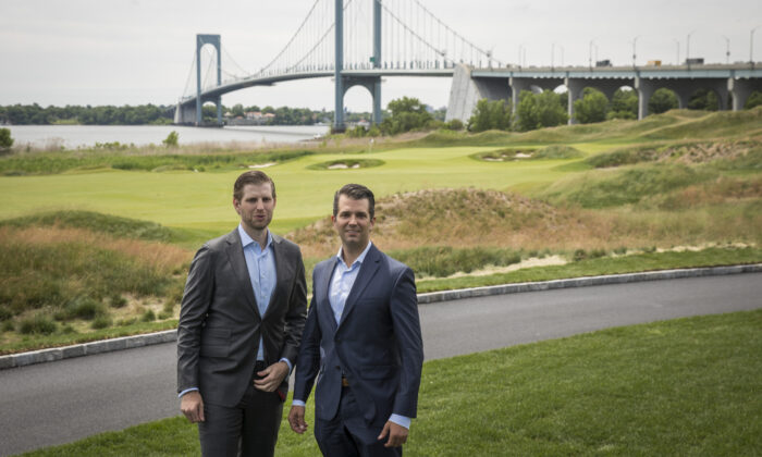 (L to R) Eric Trump and Donald Trump Jr. pose for photos during a ribbon cutting event for a new clubhouse at Trump Golf Links at Ferry Point in The Bronx borough of New York City, on June 11, 2018. (Drew Angerer/Getty Images)