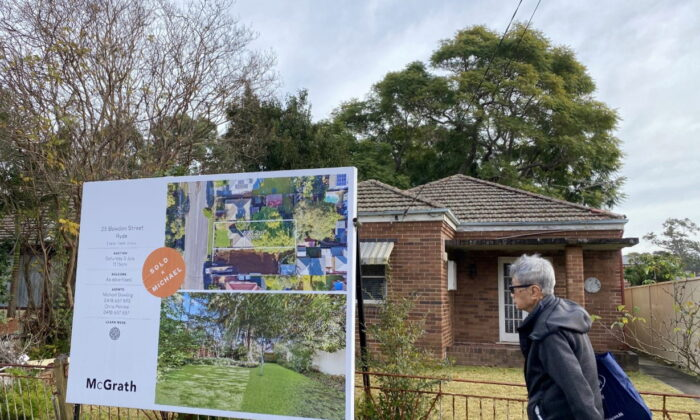 A man walks past a derelict home, which sold for A$1.6 million ($1.2 million), in Sydney's northwest in Australia June 23, 2021. (Swati Pandey/Reuters)