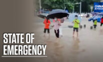 Southern Chinese City Faces Flooding, Virus Spread