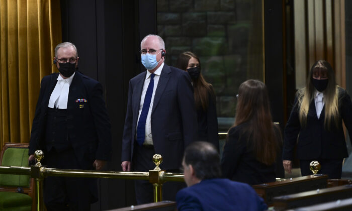 President of the Public Health Agency of Canada  Iain Stewart, second from left, approaches the bar in the House of Commons to be admonished by the Speaker of the House of Commons Anthony Rota on Parliament Hill in Ottawa on June 21, 2021. (The Canadian Press/Sean Kilpatrick)