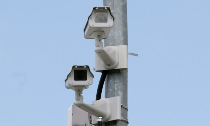 Cameras monitor a road in  Abbotsford, B.C., in a file photo. (Darryl Dyck/The Canadian Press)