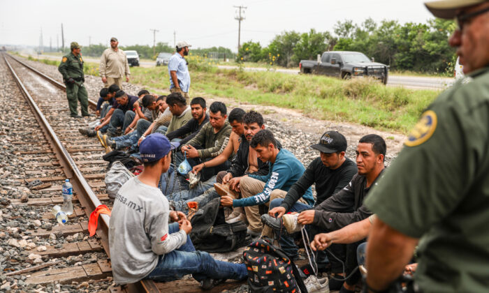 Border Patrol agents apprehend 21 illegal aliens from Mexico who had hidden in a grain hopper on a freight train heading to San Antonio, near Uvalde, Texas, on June 21, 2021. (Charlotte Cuthbertson/The Epoch Times)
