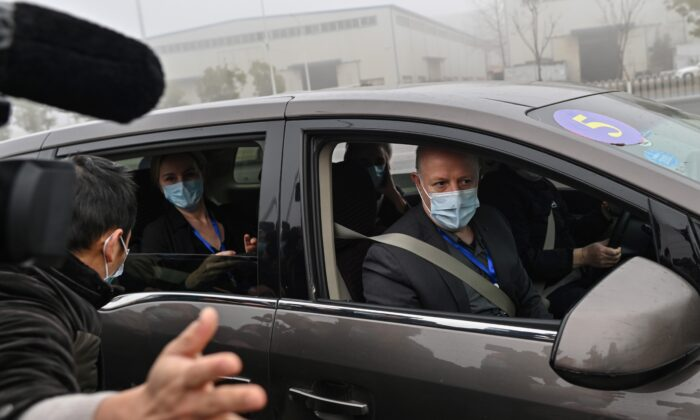 Peter Daszak (R) and other members of the World Health Organization team investigating the origins of the COVID-19 coronavirus, arrive at the Wuhan Institute of Virology in Wuhan, Hubei Province, China, on Feb. 3, 2021. (Hector Retamal/AFP via Getty Images)