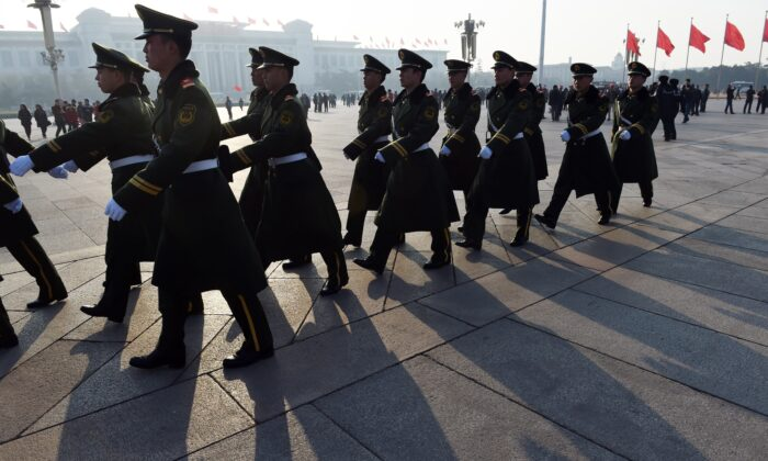 Paramilitary police patrol in Tiananmen Square, next to the Great Hall of the People, in Beijing on March 13, 2015. (Greg Baker/AFP via Getty Images)