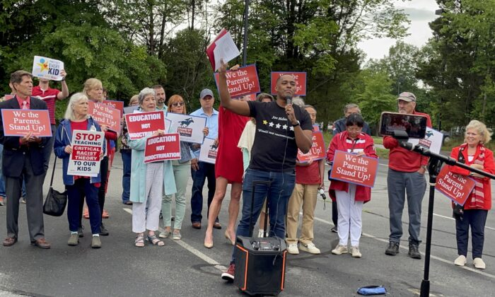 Joe Mobley with the Joe Mobley Show spoke at a rally outside the Loudoun County Public School administration building on June 22. (Terri Wu/The Epoch Times)