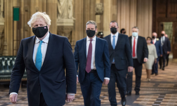Prime Minister Boris Johnson (L) and Labour leader Sir Keir Starmer (2nd L) during the State Opening of Parliament in London, on May 11, 2021. (Stefan Rousseau/WPA Pool/Getty Images)