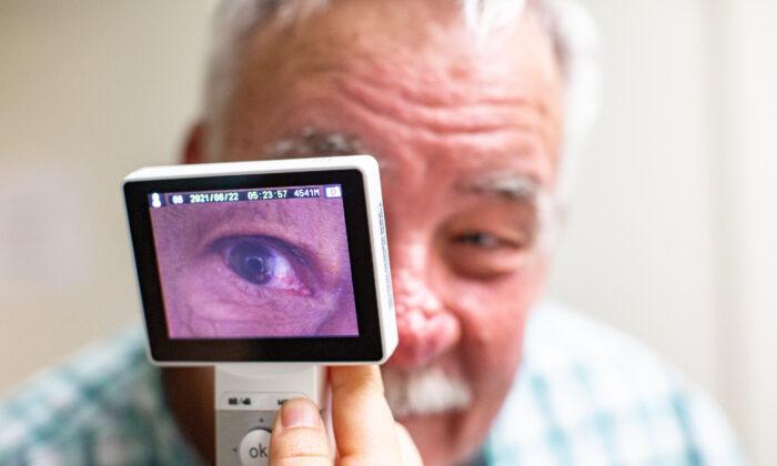 Lestonnac Free Clinic executive director Ed Gerber displays one of the telemedicine machine devices in Orange, Calif., on June 21, 2021. (John Fredricks/The Epoch Times)