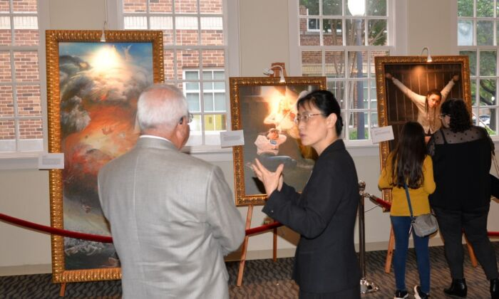 """Visitors view paintings in """"The Art of Zhen Shan Ren International Art Exhibtion"""" at the Gallery @ Courtyard in Plano, Texas. (Southern USA Falun Dafa Association)"""
