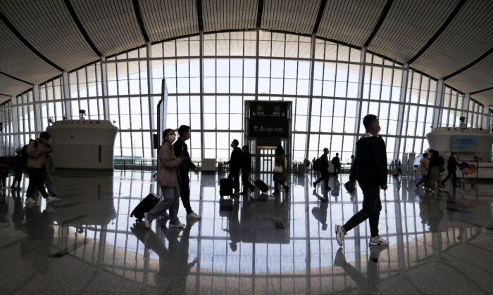 Travellers are seen at the Beijing Daxing International Airport on the first day of Labour Day holiday, in Beijing, China, on May 1, 2021. (Tingshu Wang/File Photo/Reuters)