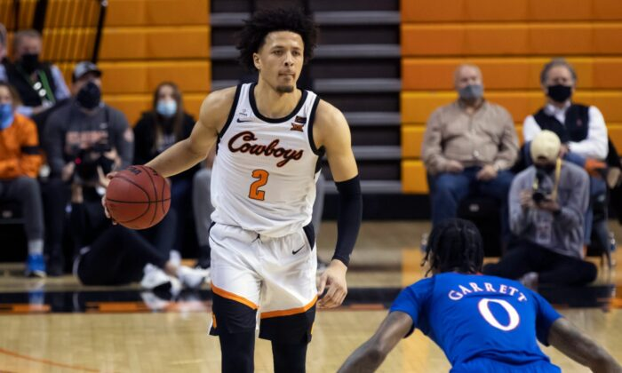 Oklahoma State's Cade Cunningham (2) brings the ball up the court during the second half of the NCAA college basketball game against Kansas in Stillwater, Okla., on Jan. 12, 2021. (Mitch Alcala/File/AP Photo)