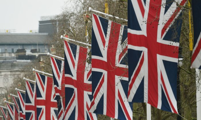 Flags line The Mall leading to Buckingham Palace in an undated photo. (PA)