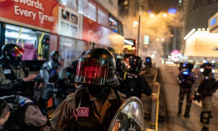 Riot police react after firing teargas to disperse protesters in Hong Kong, China on Dec. 24, 2019. (Anthony Kwan/Getty Images)