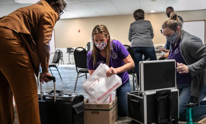 Ingham County Clerk Barb Byrum handles ballot tabulations in Mason, Mich., on Nov. 4, 2020. (John Moore/Getty Images)