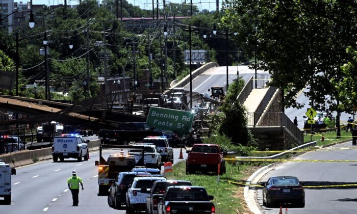 People work on the scene of a collapsed pedestrian bridge along Kenilworth Avenue & Polk Street Northeast in Washington, on June 23, 2021. (Marvin Joseph/The Washington Post via AP)