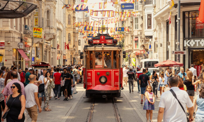 A tram moves along Istiklal Avenue towards Taksim Square on June 9, 2019. Although it is the main street, you can find some tucked-away spots along the way. (Vakidzasi/Shutterstock)