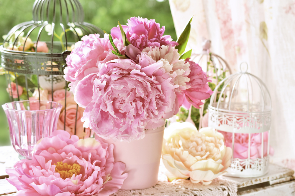 Pink,Peony,Bunch,In,Vase,And,Vintage,Bird,Cages,On