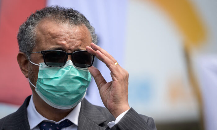 World Health Organization (WHO) Director-General Tedros Adhanom Ghebreyesus adjusts his glasses during a meeting in front of the WHO headquarters in Geneva on May 29, 2021. (Fabrice Coffrini/AFP via Getty Images)