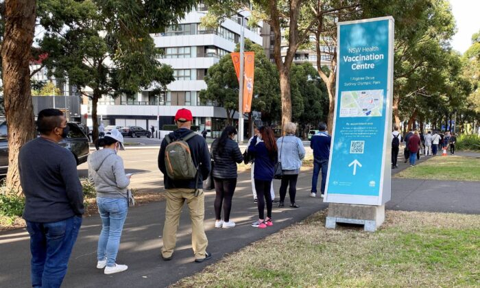 People wait in line outside a coronavirus disease (COVID-19) vaccination centre at Sydney Olympic Park in Sydney, Australia, on June 23, 2021. (Jane Wardell/Reuters)