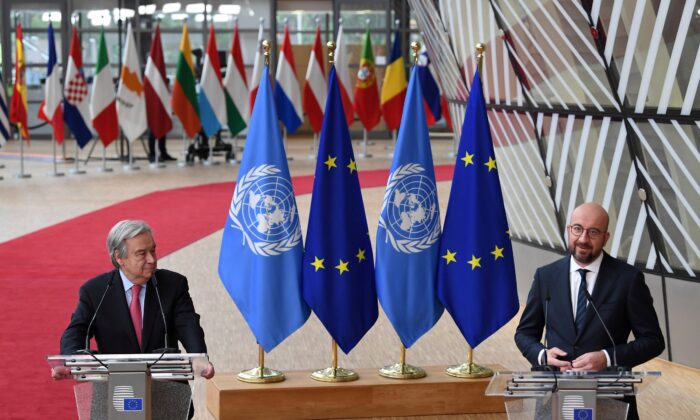 United Nations Secretary-General Antonio Guterres and European Council President Charles Michel address the media as they arrive on the first day of the European Union summit at the European Council Building in Brussels, on June 24, 2021. (John Thys/Pool via Reuters)