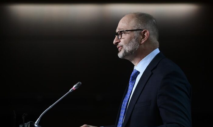 David Lametti, Minister of Justice and Attorney General of Canada, delivers a statement on Bill C-7 during a media availability on Parliament Hill in Ottawa on March 11, 2021. (The Canadian Press/Sean Kilpatrick)