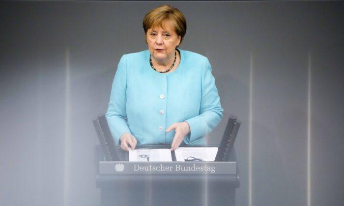 German Chancellor Angela Merkel delivers her speech ahead of an EU summit at the German Bundestag in Berlin, Germany, on June 24, 2021. (Markus Schreiber/AP Photo)