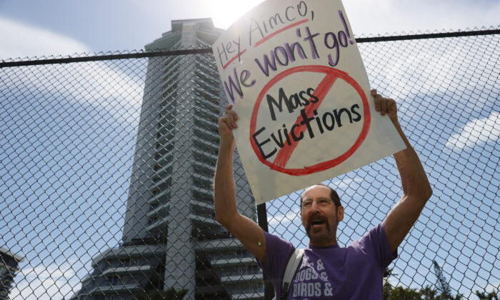 Tenants of the Hamilton on the Bay apartment building protest eviction notices in Miami on June 8, 2021. (Joe Raedle/Getty Images)