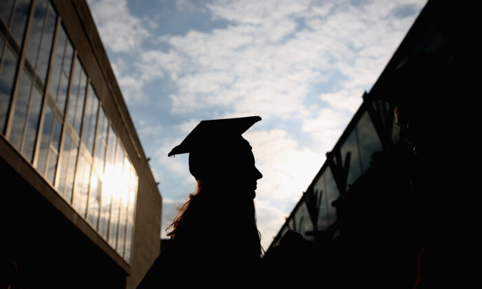 In this file image, a students arrives for their graduation ceremony at the Royal Festival Hall on October 13, 2015 in London, England. (Dan Kitwood/Getty Images)