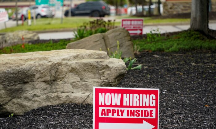 Hiring signs posted outside a gas station in Cranberry Township, Butler County, Pa., on May 5, 2021. (Keith Srakocic/AP Photo)