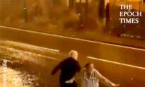 Elderly Couple Go Surfing on Ironing Board in the Rain