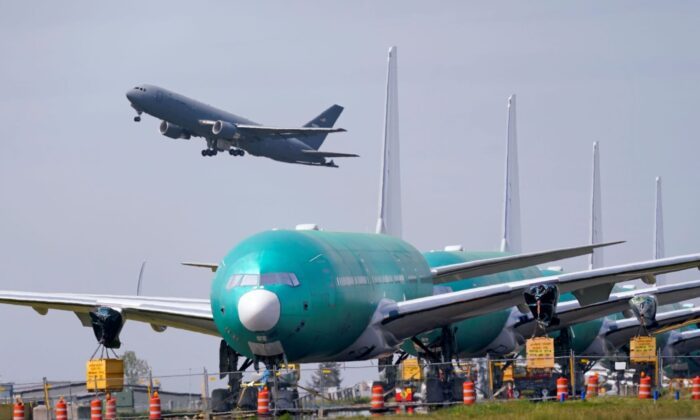 A U.S. Air Force KC-46A Pegasus jet takes off at Paine Field, near Boeing's production facility in Everett, Wash., on April 23, 2021. (Elaine Thompson/AP Photo)