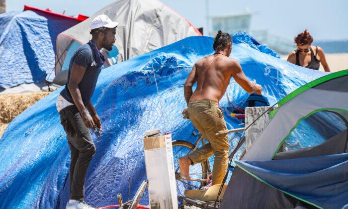 Homeless individuals in Venice Beach, Calif., roam around their encampments on June 8, 2021. (John Fredricks/The Epoch Times)