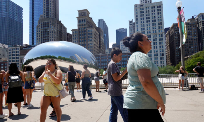 People visit Anish Kapoor's Cloud Gate sculpture in downtown Chicago, Ill., on June 11, 2021. (Scott Olson/Getty Images)