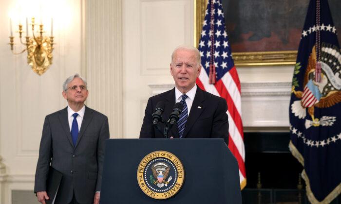 President Joe Biden speaks on gun crime prevention measures as Attorney General Merrick Garland looks on at the White House on June 23, 2021. (Kevin Dietsch/Getty Images)