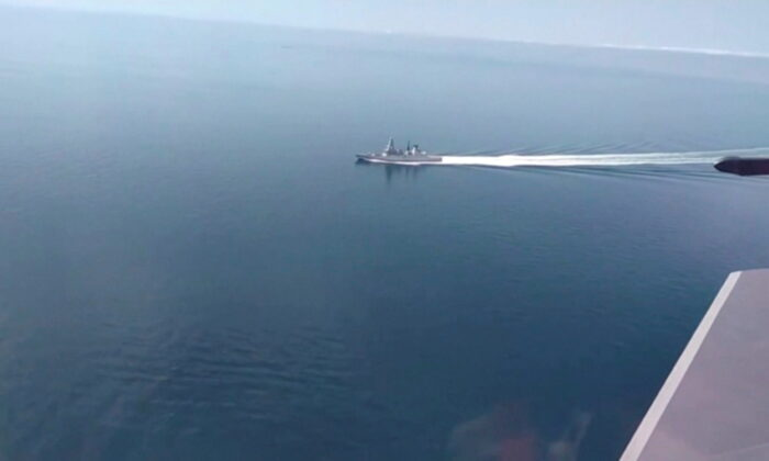 A still image taken from a video released by Russia's Defence Ministry allegedly shows British Royal Navy's Type 45 destroyer HMS Defender filmed from a Russian military aircraft in the Black Sea, on June 23, 2021. (Ministry of Defence of the Russian Federation/Handout via Reuters)