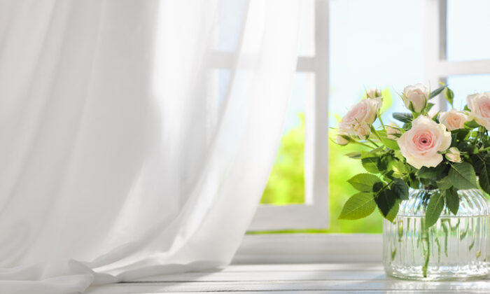 Drapes, blinds, and shades are all very effective in reflecting the heat of the sun. (fotohunter/Shutterstock)