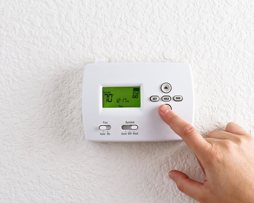 Digital,Thermostat,With,Finger,Pressing,Button